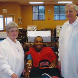 Donna and Jerry Hobson with Biomat plasma donor Mathews Rainer