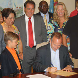 Delaware Governor Jack Markell signs SB 35 into law, July 23, 2013.